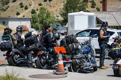 YELLOWSTONE NATIONAL PARK, WYOMING, USA - JULY 17, 2017: Group of bikers visiting Mammoth Hot Springs in Yellowstone National Park. Group of bikers visiting Royalty Free Stock Photo