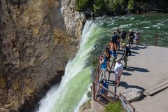 YELLOWSTONE NATIONAL PARK, WYOMING, USA - JULY 17, 2017: Tourists and a tour guide watching and taking pictures of Lower Yellowsto. Tourists and a tour guide Stock Photos