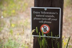 YELLOWSTONE NP, WYOMING, USA - JULY 1, 2011: Turn off your cell phone sign in Yellowstone National Park royalty free stock photos