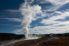 Yellowstone old  faithful. Yellowstone old faithful eruption in perfect day Royalty Free Stock Photo