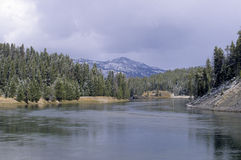 Yellowstone River. The land around the Yellowstone River is dusted with snow.  Winter has just begun to arrive in the Rocky Mountains of Yellowstone National Stock Images
