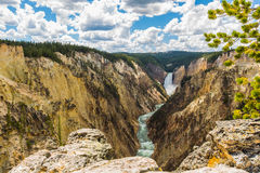 Yellowstone waterfalls. Under blue sky and white cloud stock image