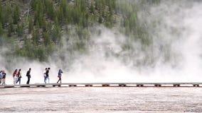 YELLOWSTONE, WY - JULY 2019: Tourists visit Midway Geyser Basin - Yellowstone National Park, WY - USA