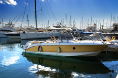 Yelow boat on dock Stock Photos