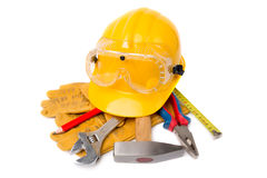 Yelow helmet with leather gloves and earmuffs tool Stock Photo