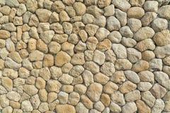 Yelow owalu kamienie w ścianie jak tło Zdjęcia Stock