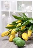 Yelow tulips, Easter eggs and decorations in a shadowcase Stock Photography