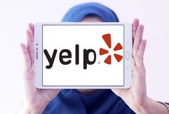 Yelp company logo. Logo of Yelp on samsung tablet holded by arab muslim woman. Yelp is an American multinational corporation. It develops, hosts and markets Yelp Royalty Free Stock Photography