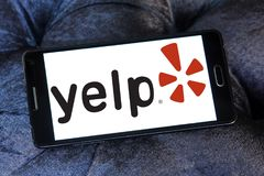 Yelp company logo. Logo of Yelp on samsung mobile. Yelp is an American multinational corporation. It develops, hosts and markets Yelp.com and the Yelp mobile app Stock Photography