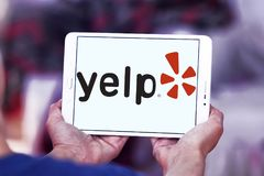 Yelp company logo. Logo of Yelp on samsung tablet . Yelp is an American multinational corporation. It develops, hosts and markets Yelp.com and the Yelp mobile Royalty Free Stock Photography