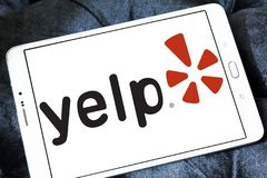 Yelp company logo. Logo of Yelp on samsung tablet . Yelp is an American multinational corporation. It develops, hosts and markets Yelp.com and the Yelp mobile Stock Photography