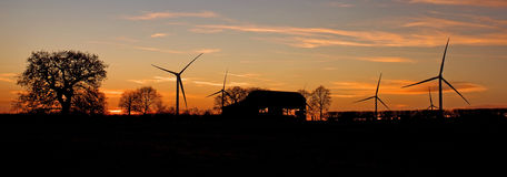 Yelvertoft Wind Farm Silhouetted at Sunset Royalty Free Stock Photography