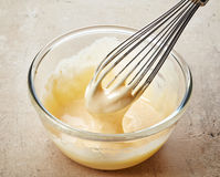 Yema de huevo azotada con el azúcar Imagen de archivo libre de regalías
