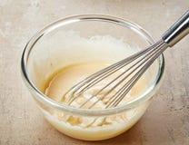 Yema de huevo azotada con el azúcar Fotos de archivo