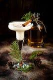 Yema del cóctel de la Navidad con nuez moscada moscada y canela rallados Fotografía de archivo libre de regalías