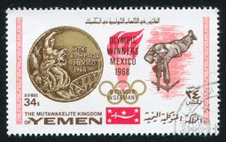 Olympic medal. YEMEN - CIRCA 1968: stamp printed by Yemen, shows Olympic medal and B.Klinger, circa 1968 Stock Photos