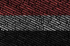 Yemen flag is depicted on the screen with the program code. The concept of modern technology and site development.  royalty free stock images