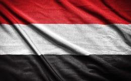 Yemen flagga flagga på bakgrund Royaltyfri Bild