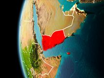 Yemen from space in evening. Evening over Yemen as seen from space on planet Earth with visible border lines and city lights. 3D illustration. Elements of this Royalty Free Stock Photo