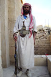 Yemeni bedouin. The portrait of a bedouin with knife and gun in the archaeological site of baraqish in the desert of yemen stock images