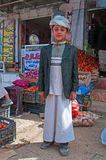 A yemeni children wearing a turban in the salt market of the Old City of Sana'a, suq, Yemen, daily life Royalty Free Stock Photography