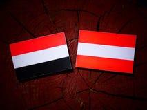 Yemeni flag with Austrian flag on a tree stump  Stock Image