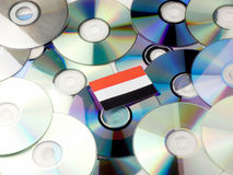 Yemeni flag on top of CD and DVD pile isolated on white. Yemeni flag on top of CD and DVD pile isolated Stock Photo