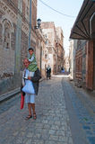 A yemeni man with a child on his shoulders walking in the streets of the Old City of Sana'a, Yemen, people, daily life. The Old City of Sana'a, the oldest Stock Photos