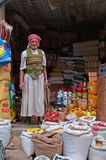 A yemeni man in his shop, salt market, Old City of Sana'a, suq, Yemen, seller, detergents, rice, drink, groceries, daily life Stock Photography