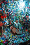 A yemeni man, seated in his shop in the salt market of the Old City of  Sana'a, suq, Yemen, seller, tools, daily life. The Old City of Sana'a, the oldest Stock Image