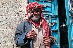 A yemeni old man smiles in the jewish quarter of the Old City of Sana'a, turban, Yemen. The Old City of Sana'a, the oldest continuously inhabited and populated stock photo