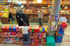 Yemeni people in the covered market inside the great suq of the Old City of Sana'a, Yemen, veiled women, boy, daily life. The Old City of Sana'a, the oldest Stock Photos