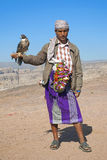 Yemeni tribal man with falcon in the desert yemen Stock Image