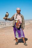 Yemeni tribal man with falcon in the desert yemen Stock Photography