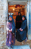 A yemeni woman and two yemeni girls in Thula, village, cistern, wooden door, Yemen Stock Photos
