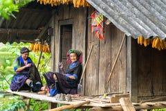 Yen Bai, Vietnam - Sep 17, 2016: Hmong ethnic minority women sewing clothing at their house.  Stock Photos