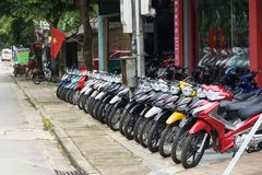 Yen Bai, Vietnam - Sep 18, 2016: Motorcycles standing in the row at a store in Van Chan district.  Royalty Free Stock Photography