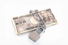 Yen bank notes with a lock and chain stock photo