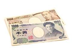 11000 Yen, 10% belastingstarief op Japanse munt Stock Fotografie