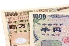 11000 Yen, 10% belastingstarief op Japanse munt Stock Foto