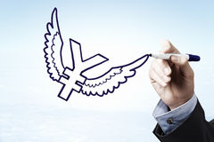 Yen currency rise. Businessman hand drawing yen flying sign on sky background Stock Photos