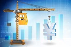 Yen di sollevamento della gru di costruzione nel concetto di affari di valuta Immagine Stock