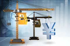 Yen di sollevamento della gru di costruzione nel concetto di affari di valuta Fotografia Stock