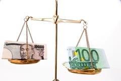 Yen ed euro soldi Fotografia Stock Libera da Diritti