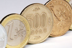 Yen, euro and dollar coins. Original macro photo yen, euro and dollar coins royalty free stock photography