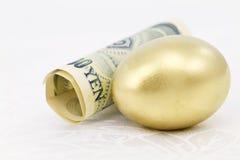 Yen and Gold Nest Egg on White Damask Stock Photo