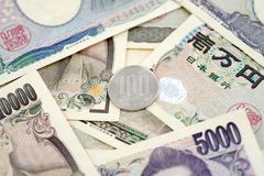 100 Yen. Japanese money 100 Yen coin on banknotes. Background business concept for marketing promotion price Stock Image