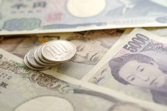 100 Yen. Japanese money 100 Yen coin on banknotes. Background business concept for marketing promotion price Stock Photo