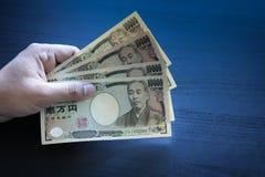 Yen merkt Geldkonzept-Hintergrund Nahaufnahme der japanischen Währung Lizenzfreies Stockfoto