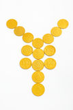 Yen shape from gold coins Stock Photo